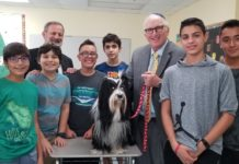Eighth-grade students with Rabbi Ira Budow and a dog