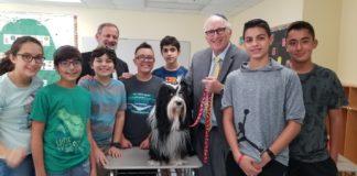 Eighth-grade students with Rabbi Ira Budow and a dog