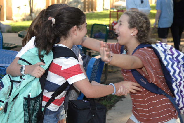 Friends greet one another at the Stern Center.