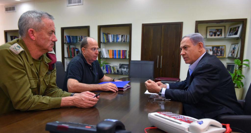 Prime Minister Benjamin Netanyahu confers with Defense Minister Moshe Yaalon, left, and Gen. Benny Gantz during the 2014 Gaza War