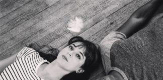 Michaela Shuchman and Dana Orange lying on a hardwood floor