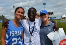 head coach alex freedman with a member from team israel and from team kenya