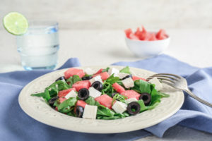 arugula salad with watermelon, olives and cheese