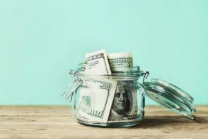 a jar full of $100 bills
