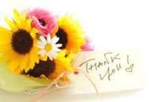 flowers with an attached thank you note