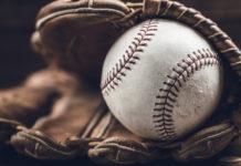 a baseball in a mitt