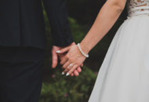 a bride and groom hold hands