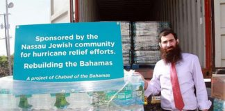 Rabbi Sholom Bluming next to supplies for hurricane relief