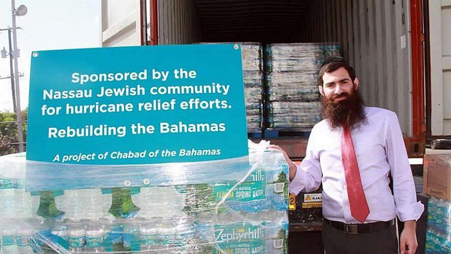 Rabbi Sholom Bluming next to supplies for hurricane relief