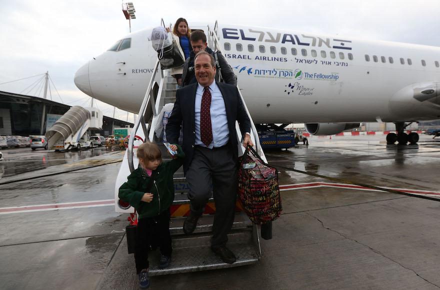 Rabbi Yechiel Eckstein coming off a plane