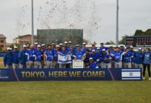 "Israel's baseball team with sign that says ""Tokyo, Here we come!"""