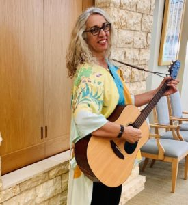 Rabbi Sigal Brier with a guitar