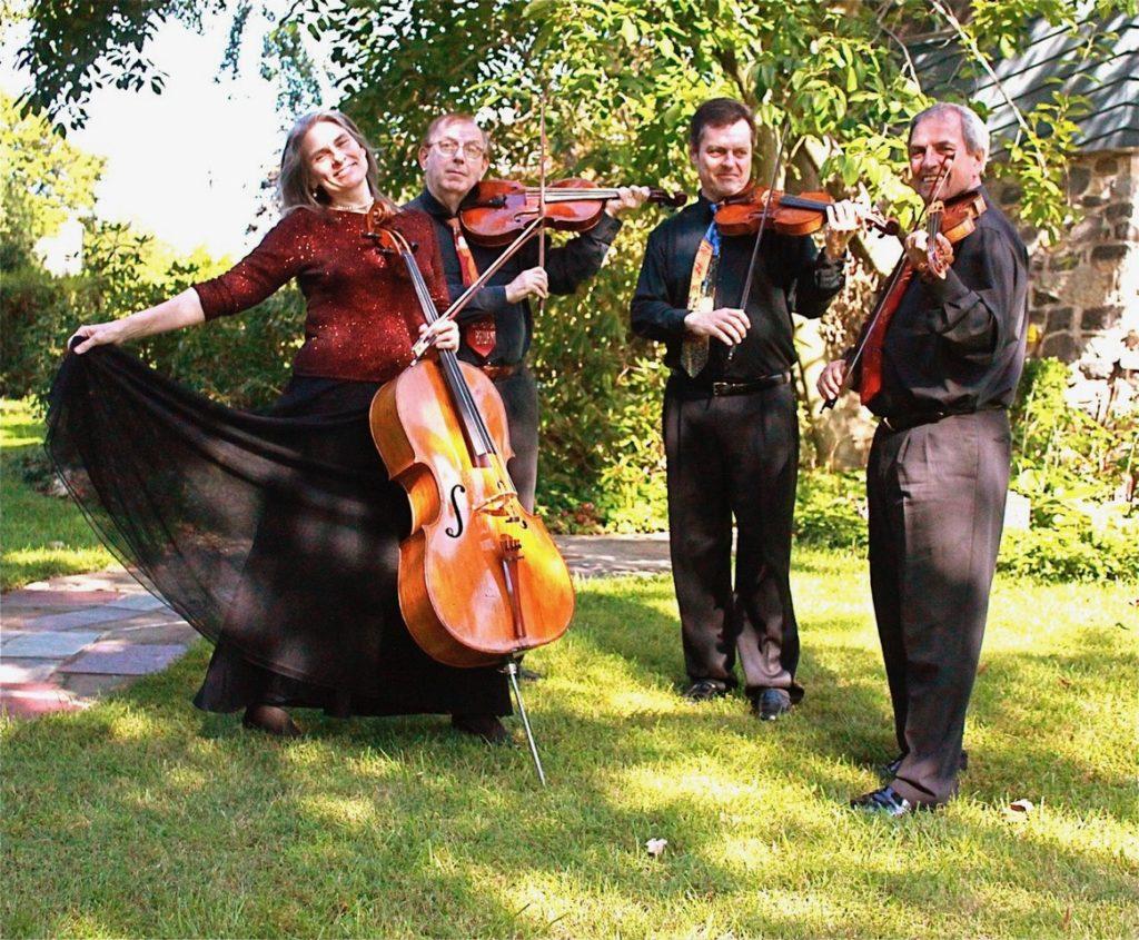 Vivian Barton Dozer, Peter Nocella, Gregory Teperman and Igor Szwec of the Meiravi Quartet holding their instruments
