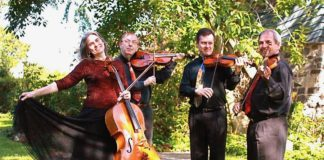Vivian Barton Dozer, Peter Nocella, Gregory Teperman and Igor Szwec of the Meiravi Quartet holding their instruments