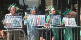 protesters dressed like statues of liberty