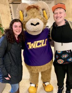 Two West Chester Hillel students flank the school mascot