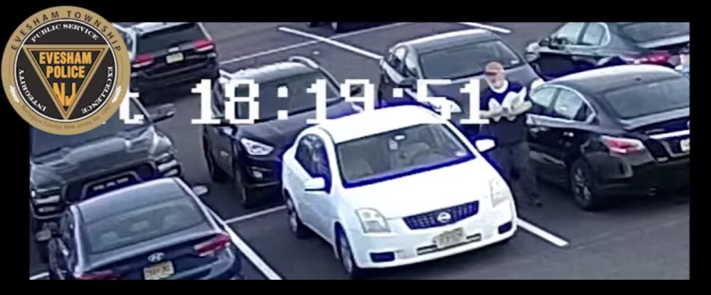 Surveillance video shows a man leaving anti-Semitic flyers on cars