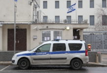 A police car outside a closed Israeli embassy in Moscow