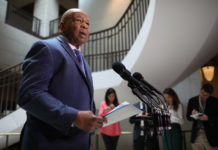 Rep. Elijah Cummings speaks into a mic
