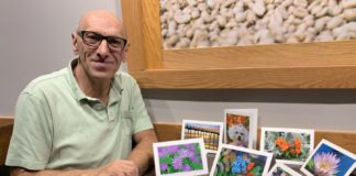 Andras Szekely with greeting cards that feature his photos