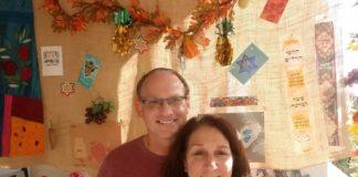 Main Line Reform Temple members Susan and Bruce Golboro in their sukkah