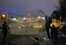community members rebuilding the sukkah in Julian Abele Park