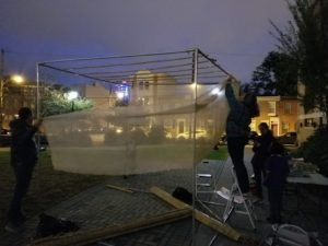 community members rebuilding the sukkah in Julian Abele Park