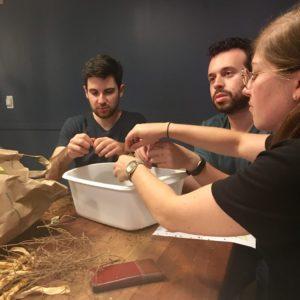 Ryan Platt, Ross Weisman and Rachel Abramowitz shell seeds