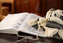 a siddur and tallit