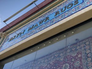 "The new sign at the store reads ""Bryn Mawr Rugs"""
