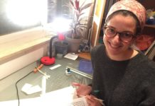 Rabbi Bec Richman writes holy texts at a desk