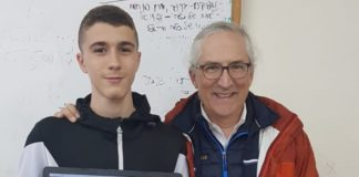 Stuart Bogom with an Israel Connect student and the student's virtual tutor on a laptop screen