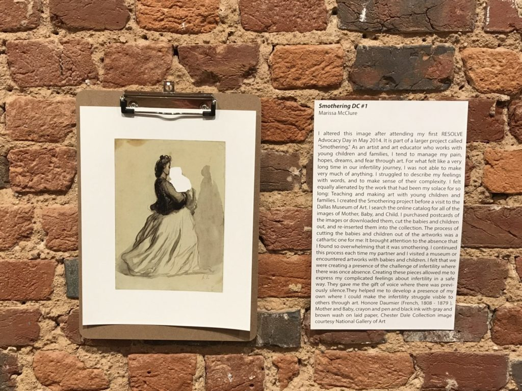 a drawing next to its description hanging on a brick wall