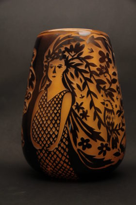 Vase with image of woman and leaves by Noa Fein