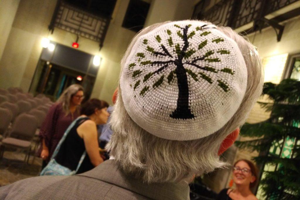 Rabbi Hazzan Jeffrey Myers wears a Tree of Life kippah gifted from Uganda