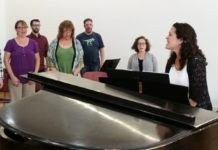 Cantor Lynn Torgove leads vocal warmups with Kol Arev