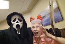 Resident Dolly Levy with someone wearing a scream mask