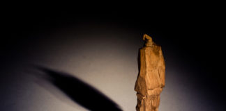 A statue of a prisoner by an unknown sculptor at Aushwitz