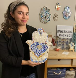 Danielle Brief holds a Hamsa