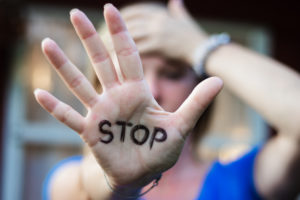 woman with stop written on her hand