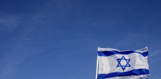 Israeli flag against a blue sky