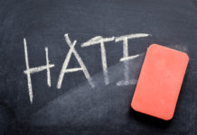 eraser erases the word hate on a chalkboard