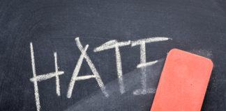 eraser erases the word hate on a chalkboard