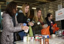 women's philanthropy volunteers sort food at the share food program