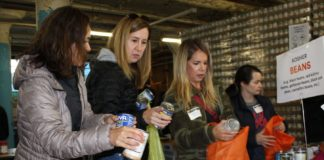 women's philanthropy volunteers sort food at the share food program