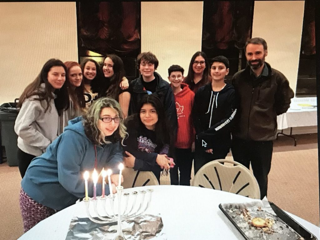 religious school students light Chanukah candles