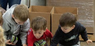 Young children help out at JRA