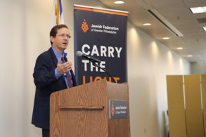 Jewish Agency Chair Issac Herzog speaks at a podium