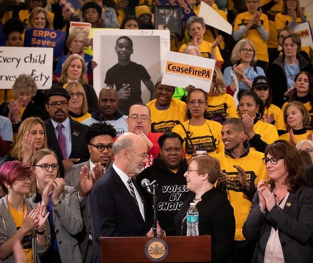 Shira Goodman with Governor Tom Wolf in front of an audience