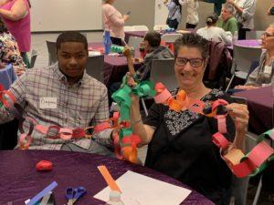 Dequan Reid and Susan Molder show off paper chains